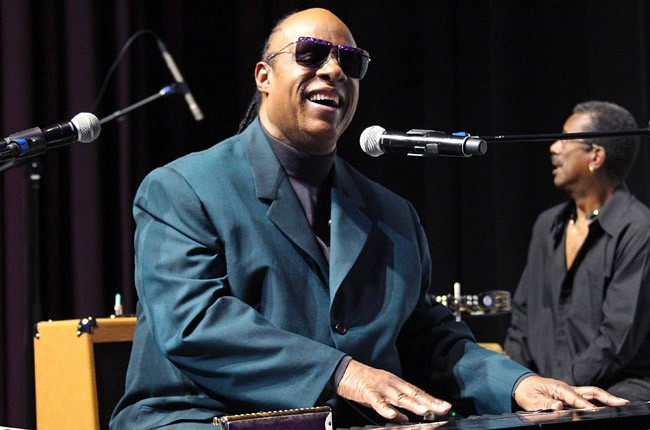 Stevie Wonder performs at a press conference announcing the 18th Annual House Full of Toys Benefit Concert at Club Nokia on October 29, 2013