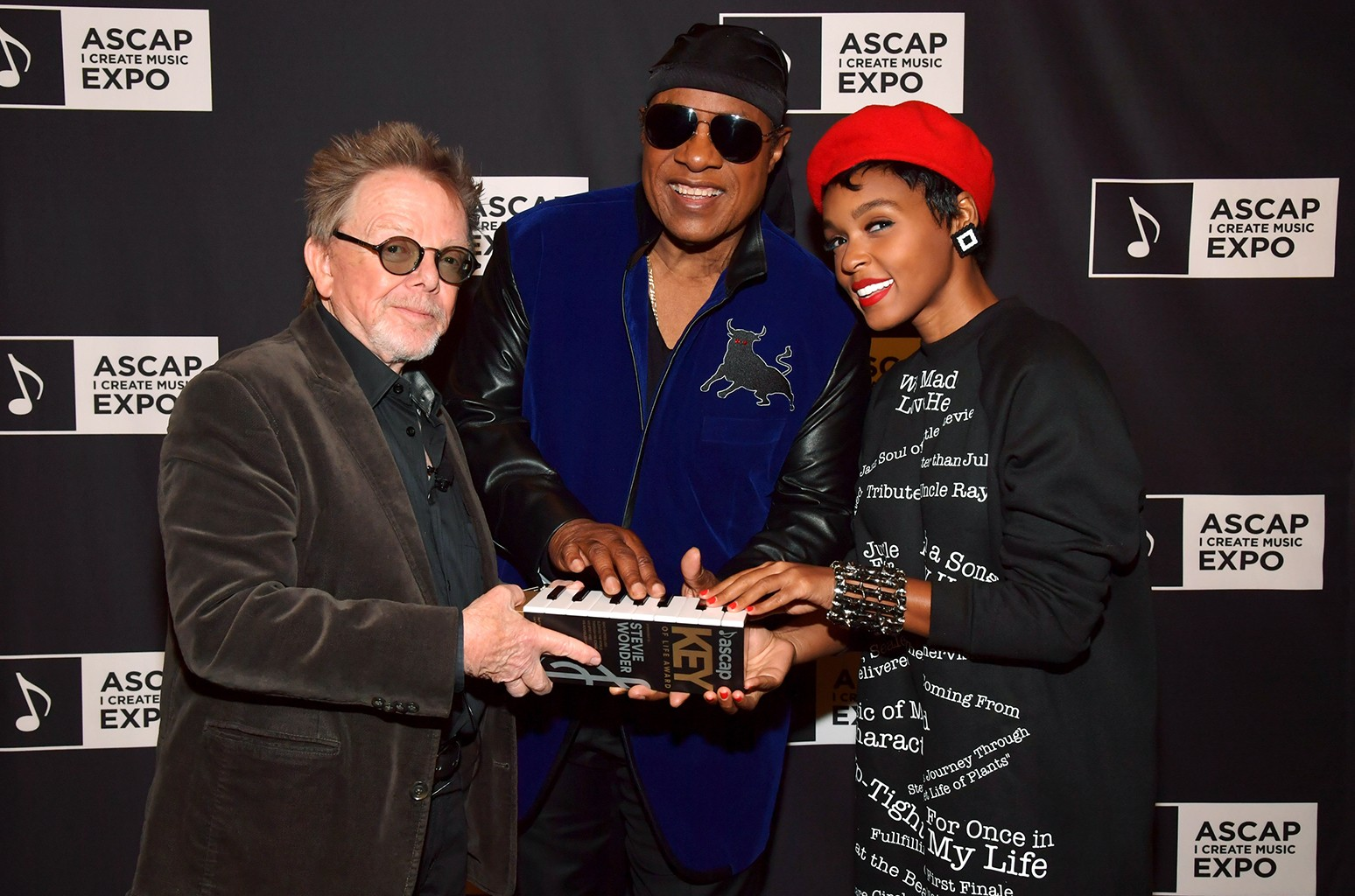 "(L-R) ASCAP President Paul Williams, Stevie Wonder and Janelle Monae attend Stevie Wonder presented with ""Key of Life"" Award at the ASCAP ""I Create Music"" Expo on April 15, 2017 in Los Angeles."