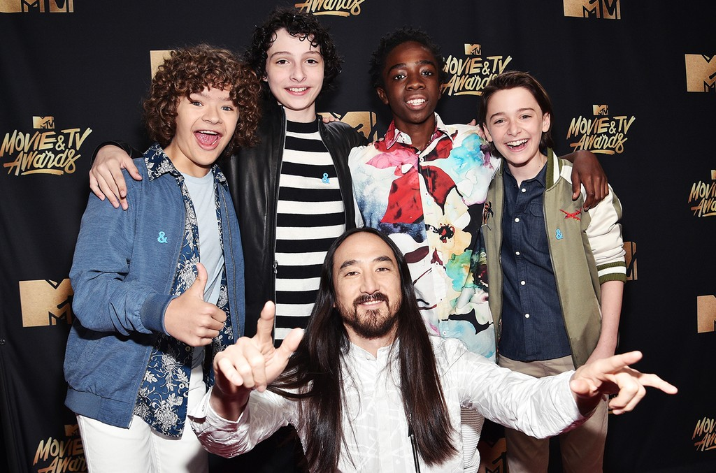 (Back, L-R) Actors Gaten Matarazzo, Finn Wolfhard, Caleb McLaughlin, Noah Schnapp and (front) DJ Steve Aoki attend the 2017 MTV Movie and TV Awards at The Shrine Auditorium on May 7, 2017 in Los Angeles.