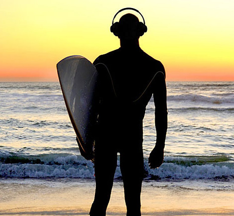 SURFER WITH HEADPHONES TOP 30 SUMMER SONGS