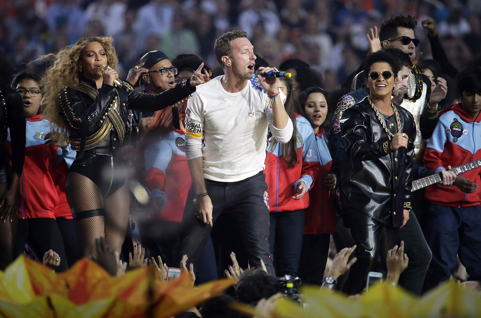 Beyoncé, Chris Martin and Bruno Mars perform during halftime of the NFL Super Bowl