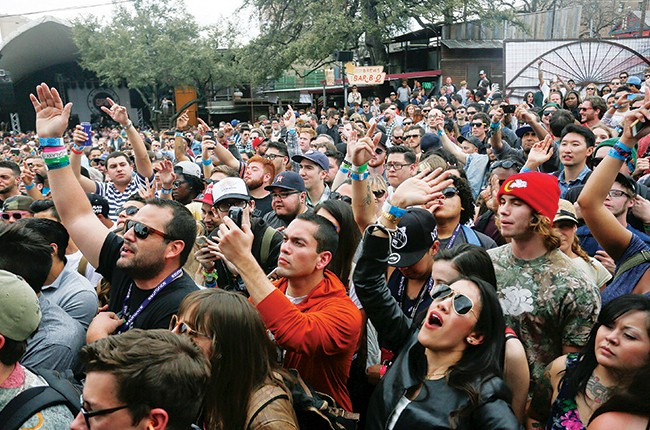 crowd cheers for Schoolboy Q at the SPIN day party during the SXSW Music Festival Friday March 14, 2014