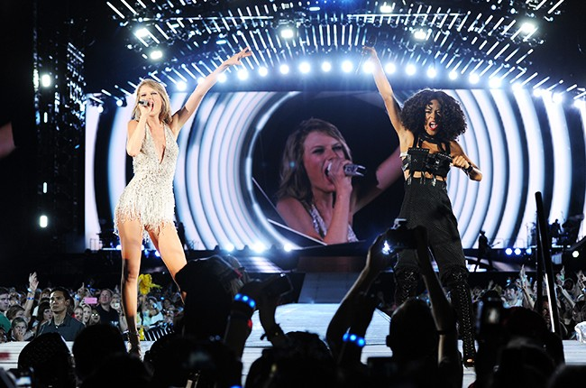 Taylor Swift and Serayah McNeill perform during The 1989 World Tour at Soldier Field on July 18, 2015 in Chicago.