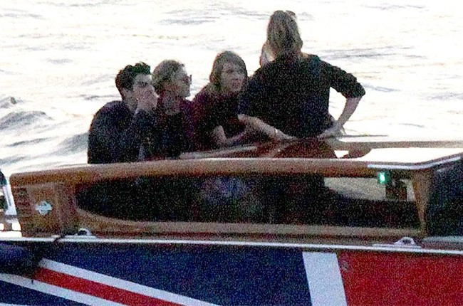 Calvin Harris, Taylor Swift, Gigi Hadid, Joe Jonas and Karlie Kloss seen on their way to O2 Arena by boat on June 28, 2015.