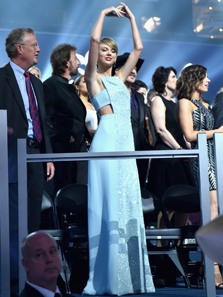 Taylor Swift dances in the audience at the 50th Academy Of Country Music Awards