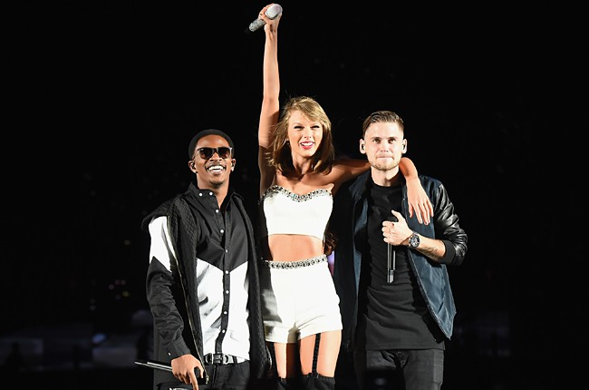 Taylor Swift performs with Malcolm Kelly and Tony Oller of MKTO