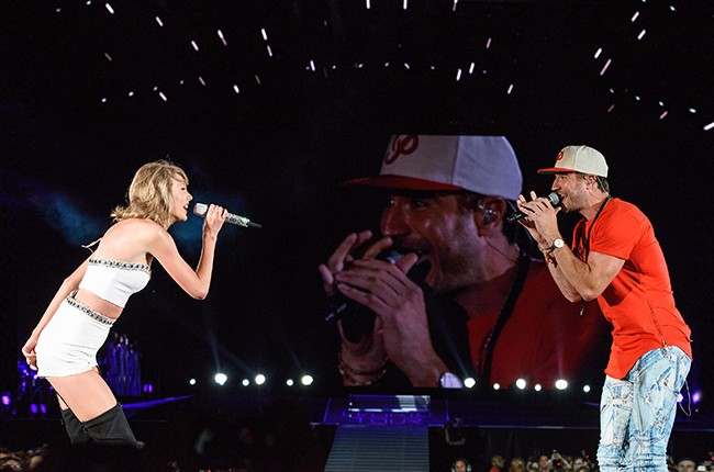 Taylor Swift and Sam Hunt perform during The 1989 Tour at Soldier Field on July 19, 2015 in Chicago, Illinois.