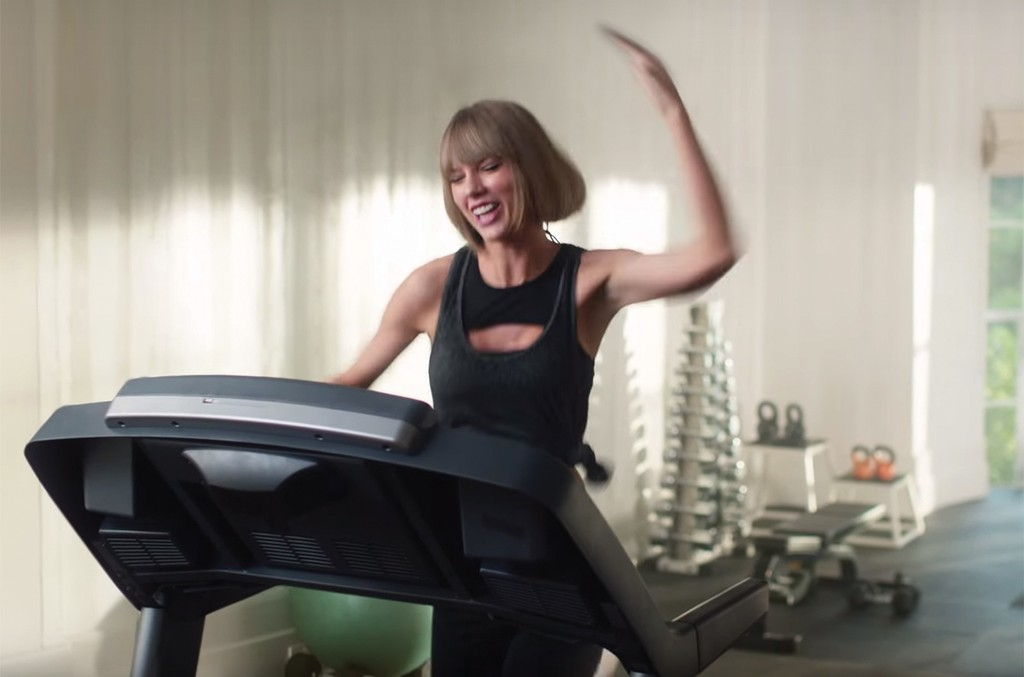 Swift in Apple Music's treadmill spot featuring music by Drake and Future.