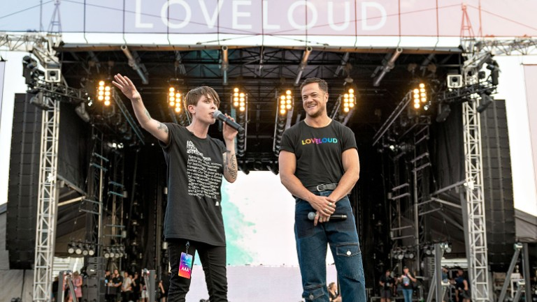 <p>Tegan Quin and Dan Reynolds speak onstage at the 2018 LOVELOUD Festival Powered by AT&amp&#x3B;T.</p>
