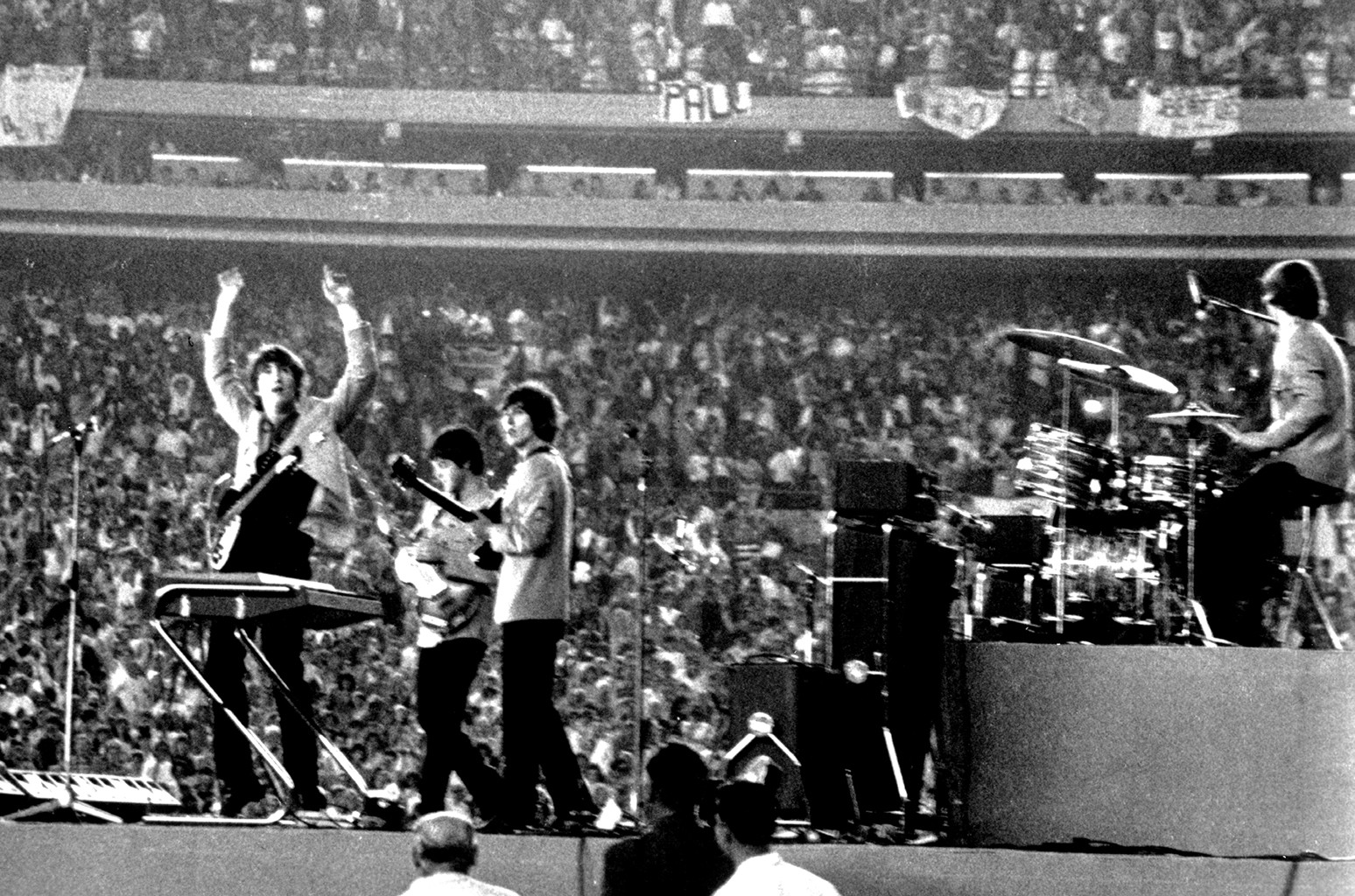 The Beatles perform at Shea Stadium
