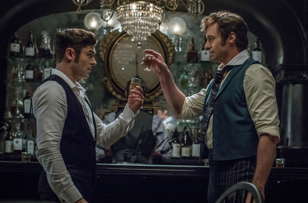 "Hugh Jackman (P.T. Barnum) and Zac Efron (Philip Carlisle) star in Twentieth Century Fox's ""The Greatest Showman."""