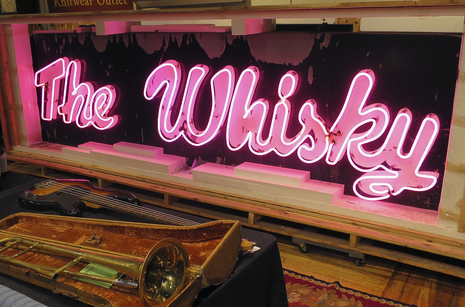 A marquee from the legendary Los Angeles rock 'n' roll club, Whisky a Go Go, glows at the Saco River Auction Co., in Biddeford, Maine on Jan. 20, 2017.