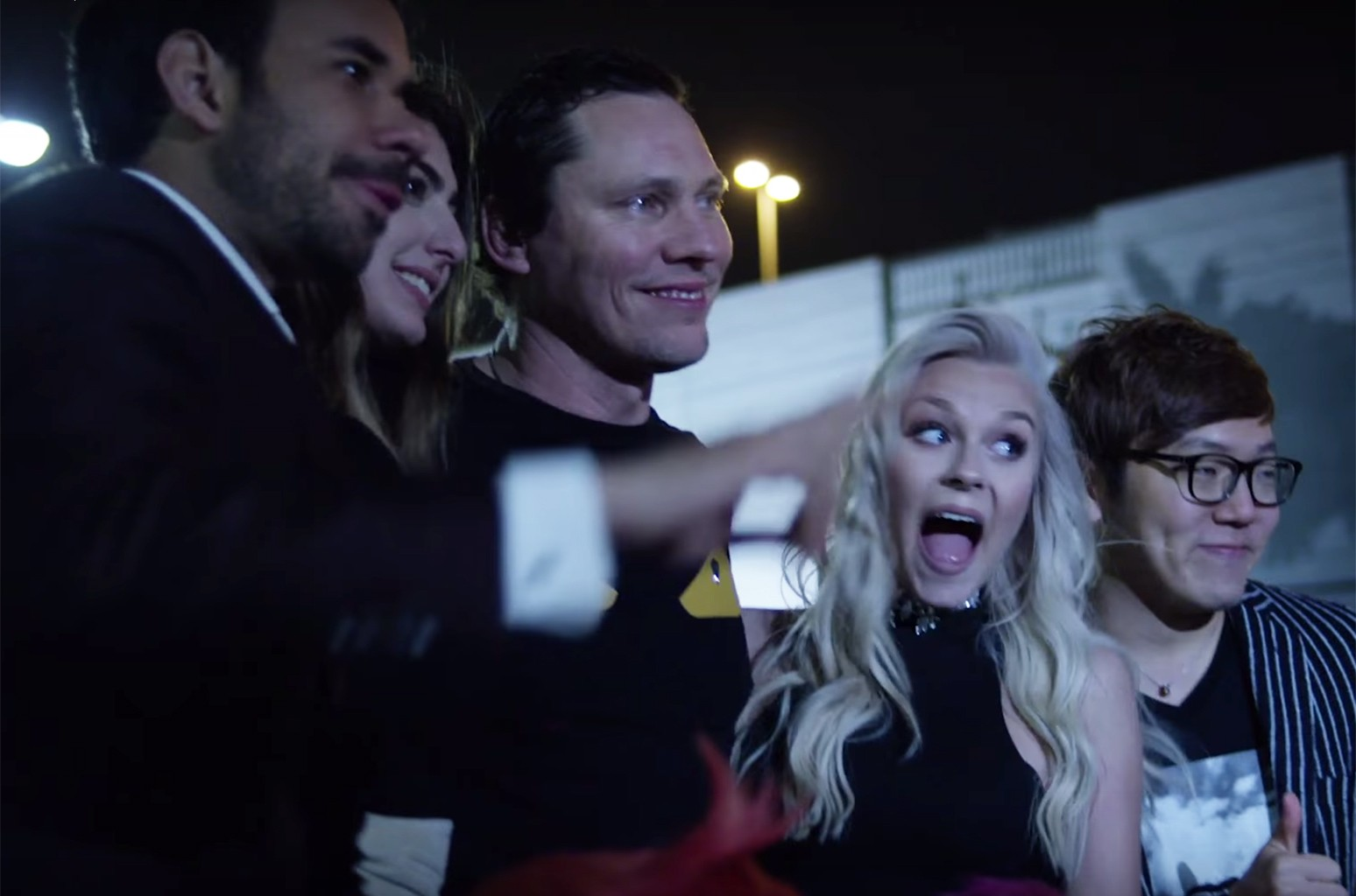 "Tiësto in the video for ""On My Way"" featuring Bright Sparks"