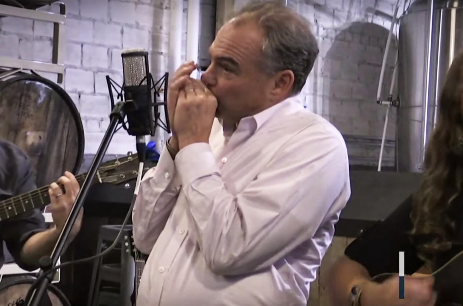 Tim Kaine plays harmonica