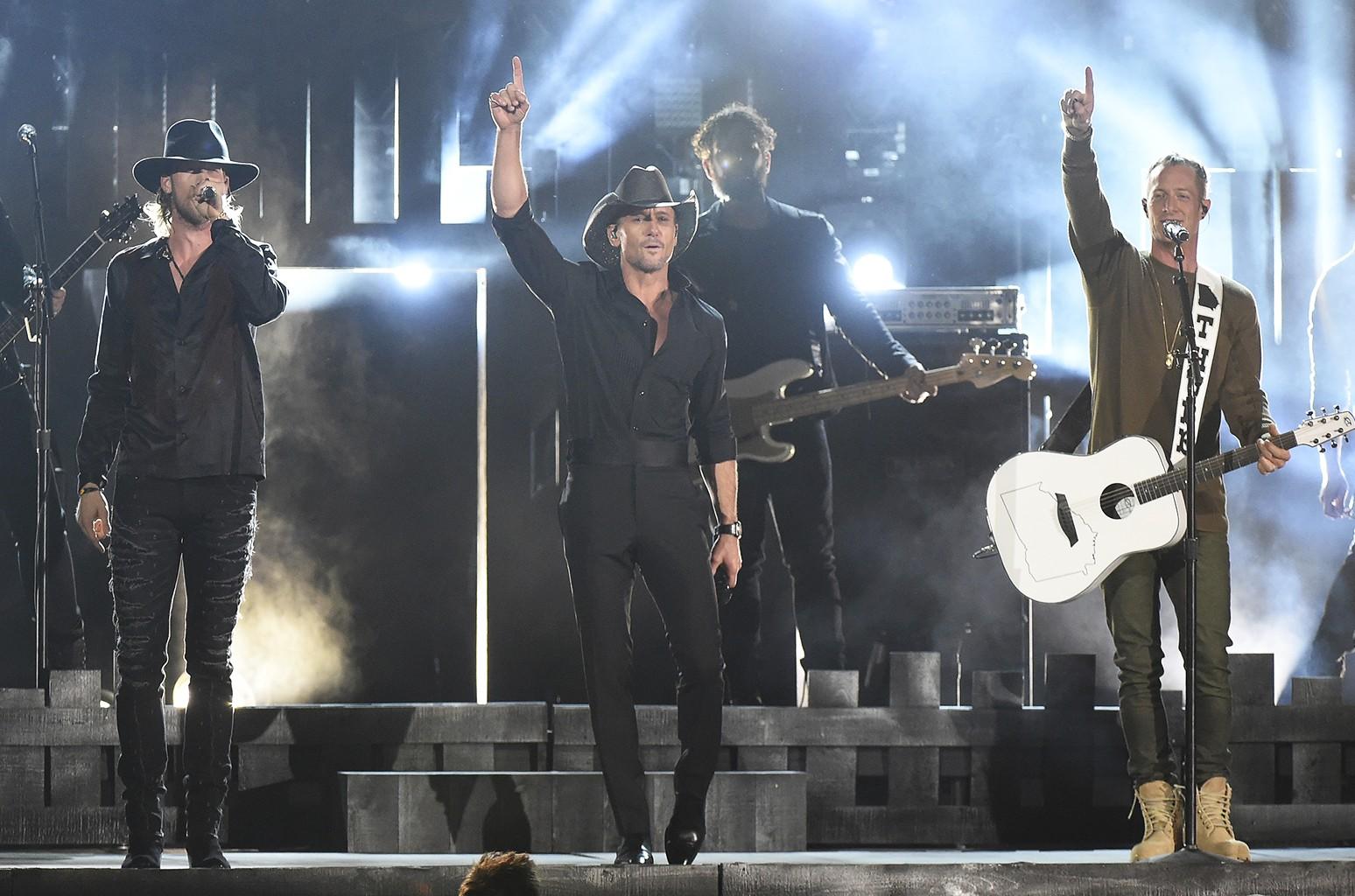 Tim McGraw and Florida Georgia Line perform at the 50th annual CMA Awards