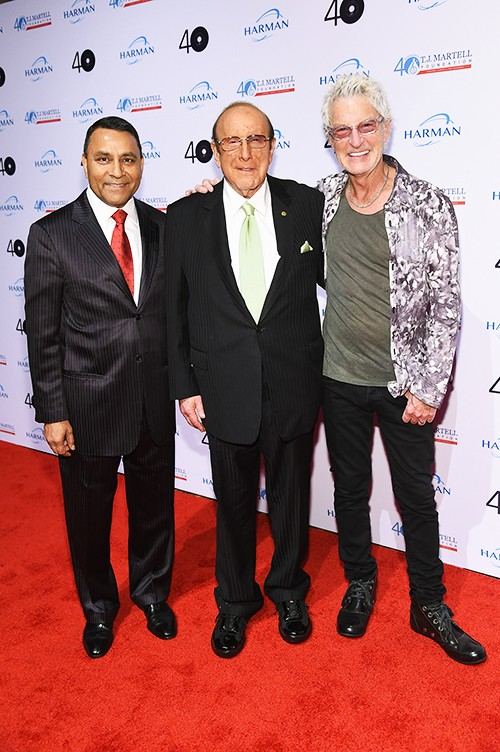 President and Chief Executive Officer of Harman International Industries Dinesh Paliwal, Clive Davis and lead singer of REO Speedwagon Kevin Cronin