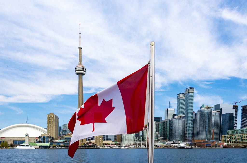 The Canadian flag and the Toronto skyline.