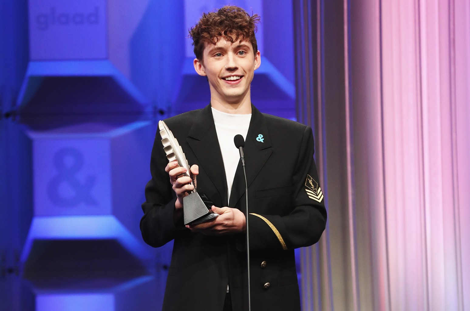 Troye Sivan accepts the Stephen F. Kolzak Award onstage during the 28th Annual GLAAD Media Awards in LA at The Beverly Hilton Hotel on April 1, 2017 in Beverly Hills, Calif.