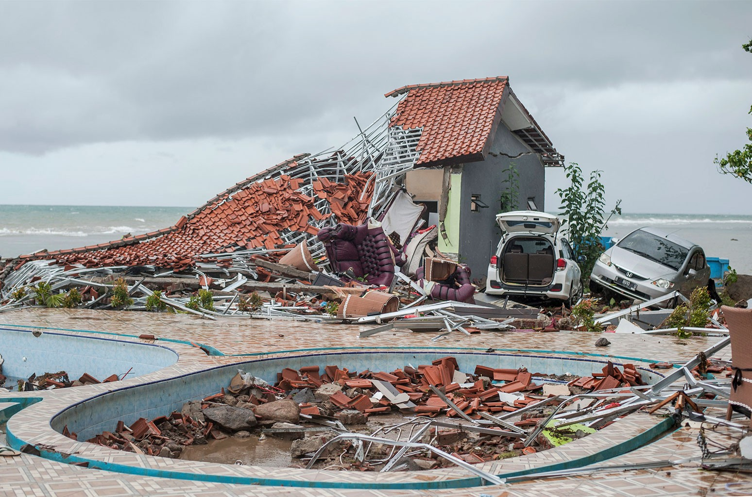 Debris littered a property badly damaged by a tsunami in Carita, Indonesia on Dec. 23, 2018.