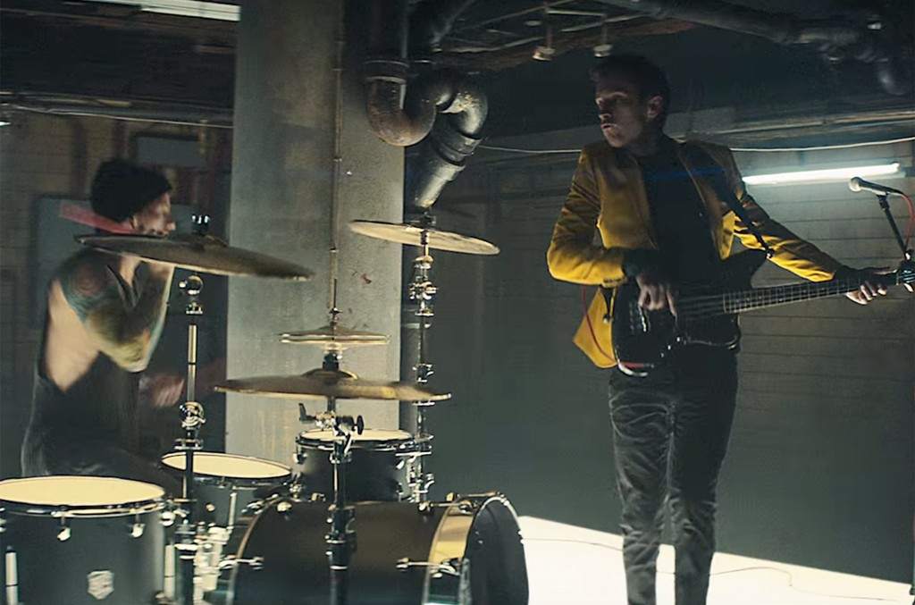 "Twenty one pilots in the video for ""Heathens."""