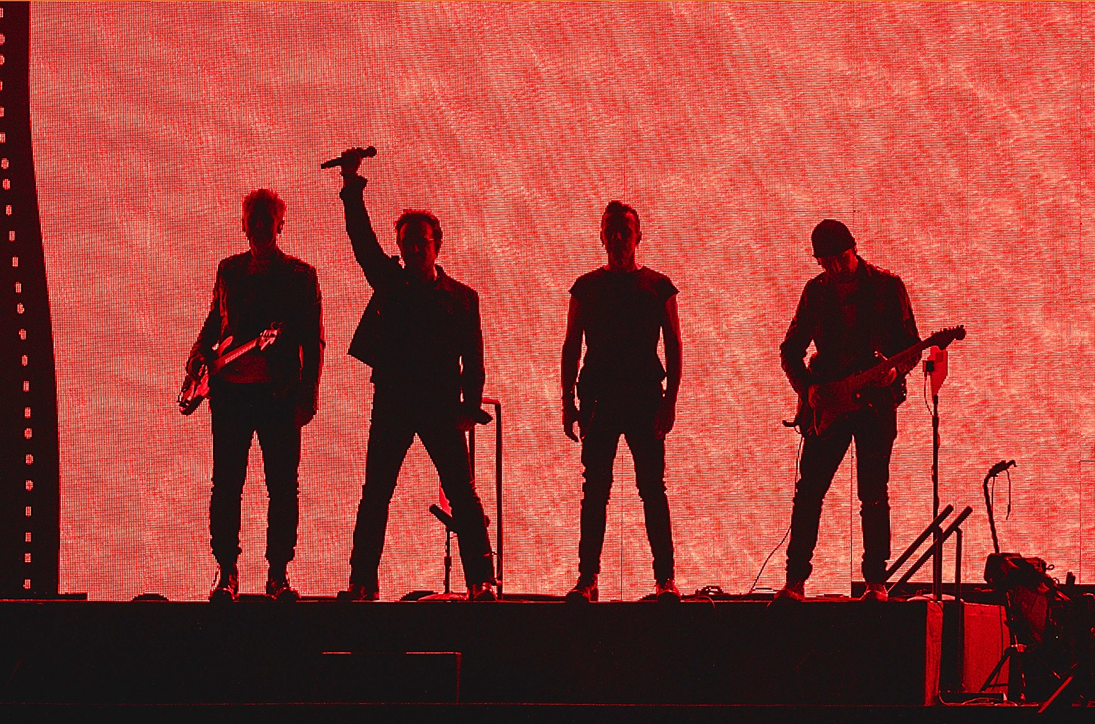 (L-R) Adam Clayton, Bono, Larry Mullen Jr., and The Edge of U2 perform in concert during The Joshua Tree Tour 2017 at NRG Stadium on May 24, 2017 in Houston, Texas.