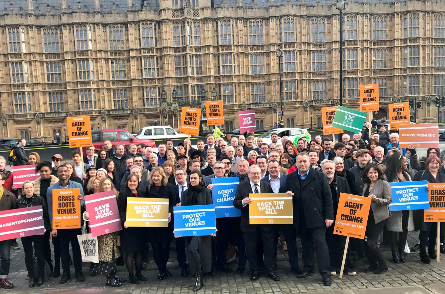 Music industry representatives gather outside Parliament in support of the agent of change bill.