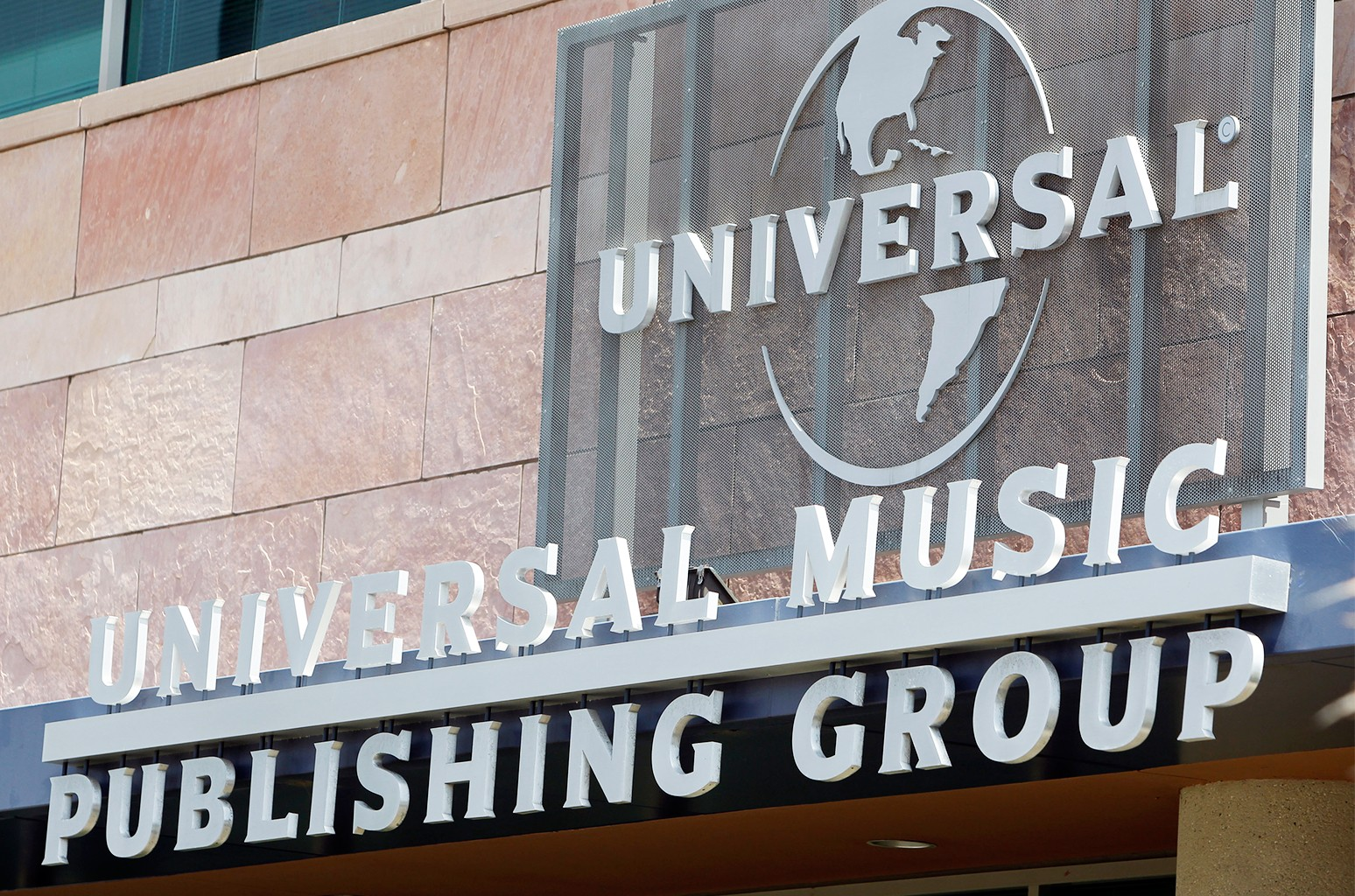 Signage of Universal Music Publishing Group hangs outside the company headquarters in Santa Monica, California.