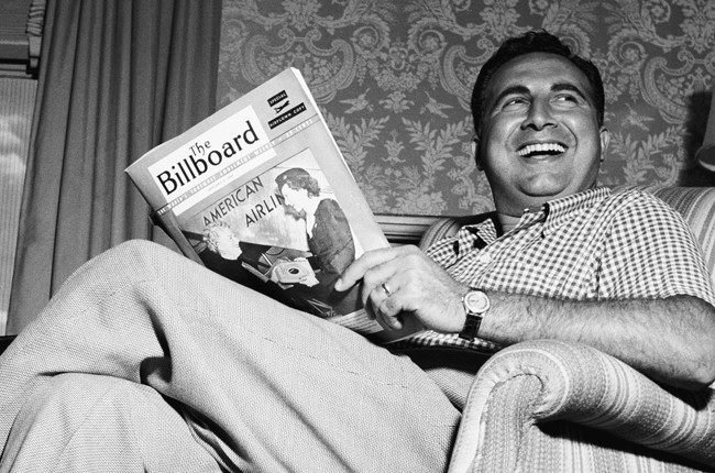 Dick Stabile reading The Billboard Magazine in the 1940s.