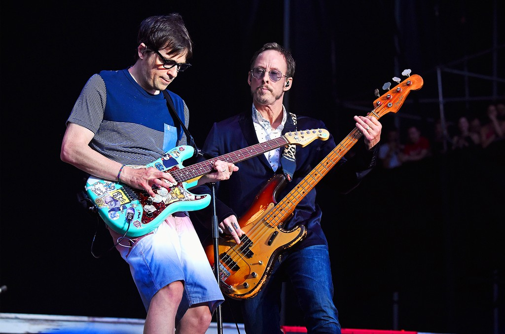 Rivers Cuomo (L) and Scott Shriner of Weezer perform onstage during the 2017 Firefly Music Festival on June 16, 2017 in Dover, Del.