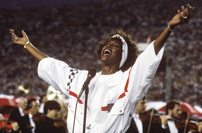 Whitney Houston sings the National Anthem at Super Bowl