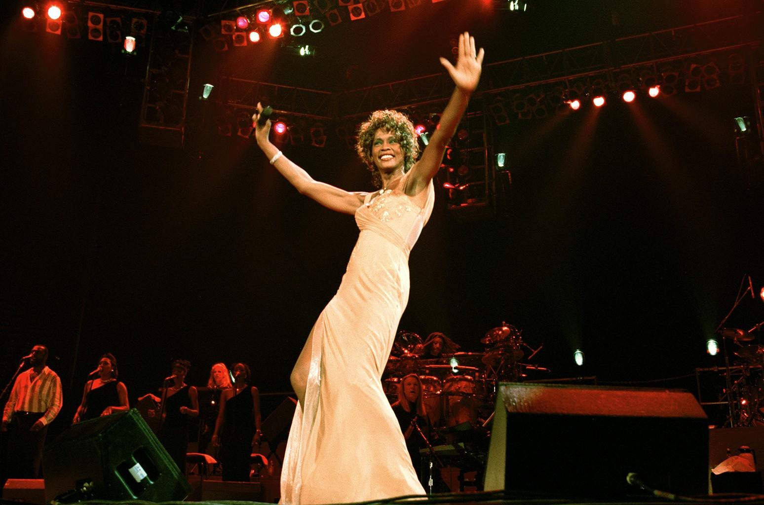 Whitney Houston performs in 1998