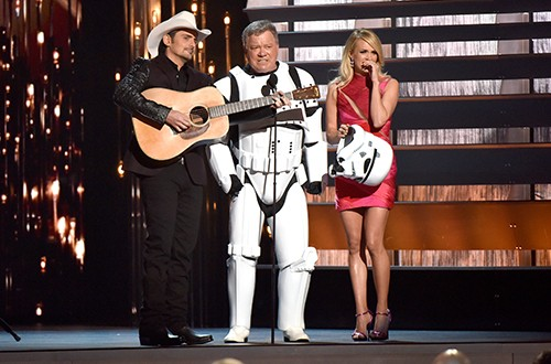 Brad Paisley, William Shatner, and Carrie Underwood speak onstage at the 49th annual CMA Awards