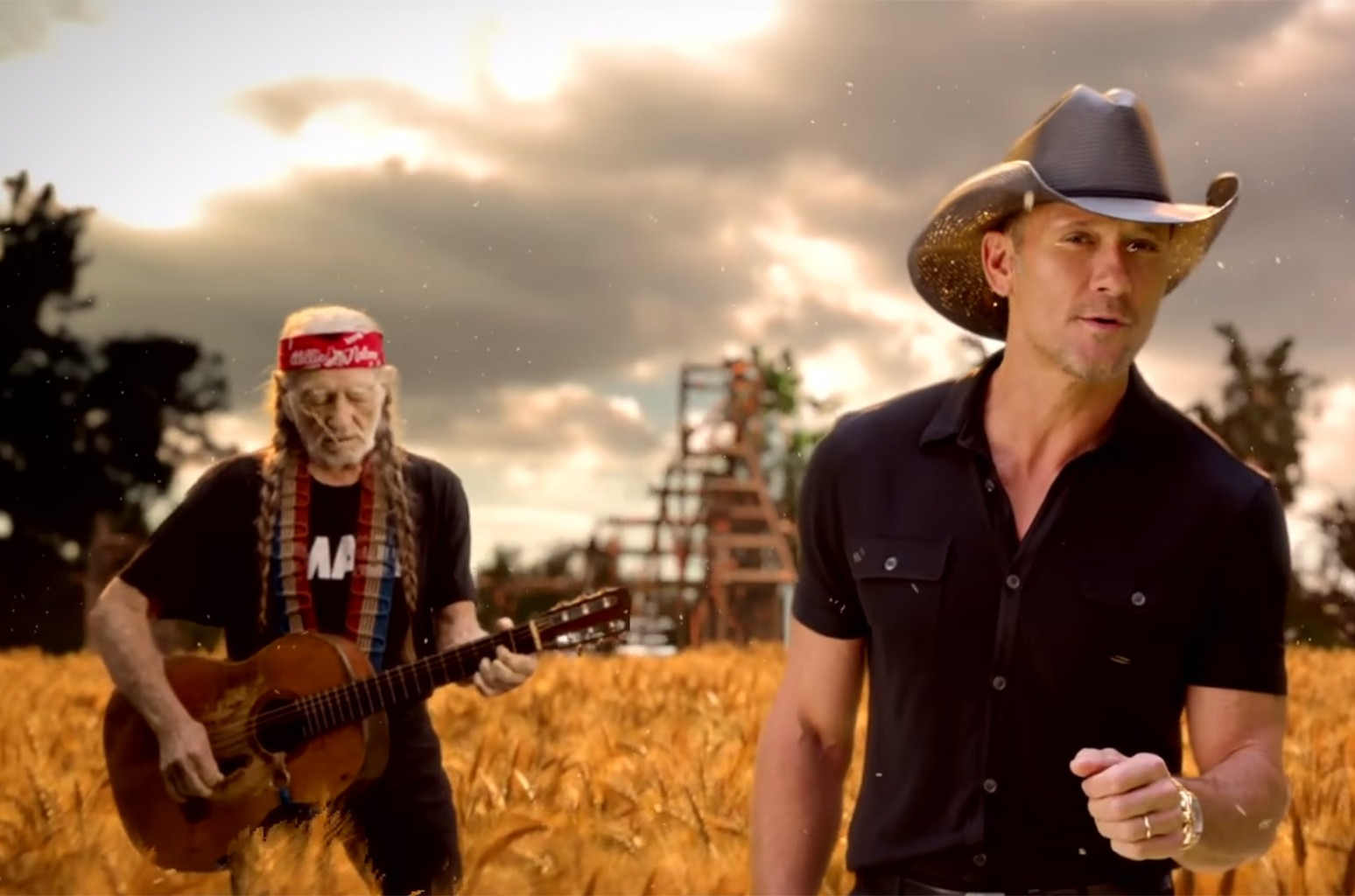 "Willie Nelson and Tim McGraw in the video for ""Forever Country."""
