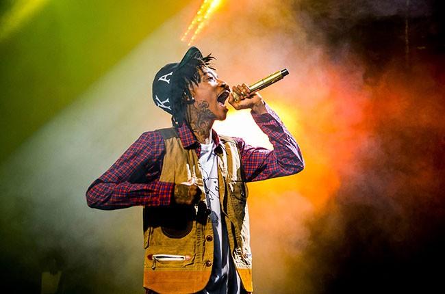 Wiz Khalifa performs in 2014.