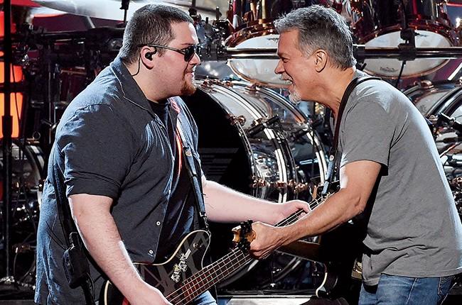 Wolfgang Van Halen and  Eddie Van Halen of Van Halen perform during the 2015 Billboard Music Awards