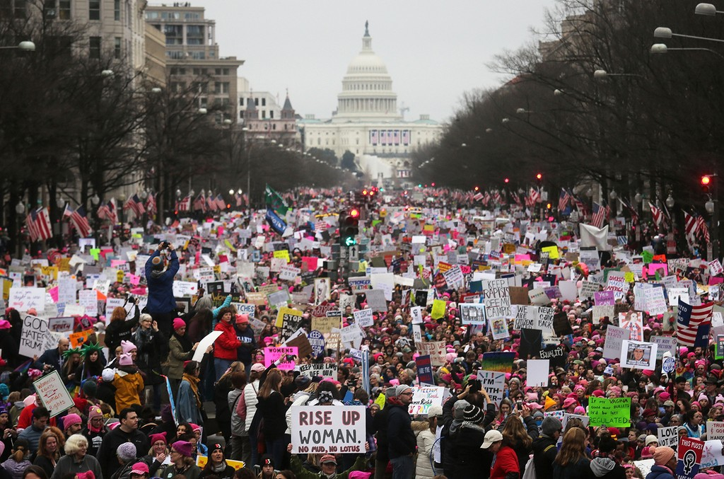 Protesters walk during the Women's March on Washington, with the U.S. Capitol in the background, on January 21, 2017 in Washington, DC. Large crowds are attending the anti-Trump rally a day after U.S. President Donald Trump was sworn in as the 45th U.S. p
