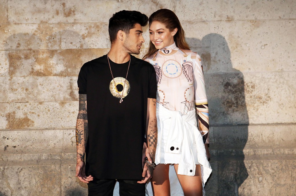 Zayn Malik and Gigi Hadid in the front row of the Givenchy show during Spring/Summer 2017 of Paris Fashion Week on Oct. 2, 2016.