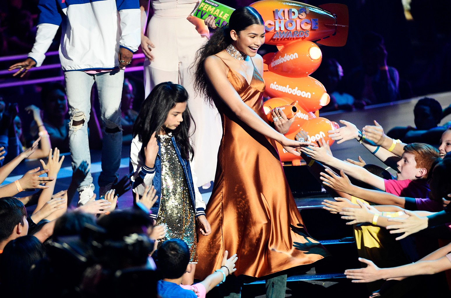 """Zendaya greets fans in the audience after accepting the award for favorite female TV star for """"K.C. Undercover"""" at the Kids' Choice Awards at the Galen Center on March 11, 2017 in Los Angeles."""