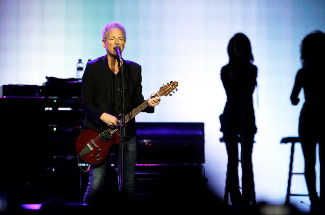Lindsey Buckingham on stage with Fleetwood Mac