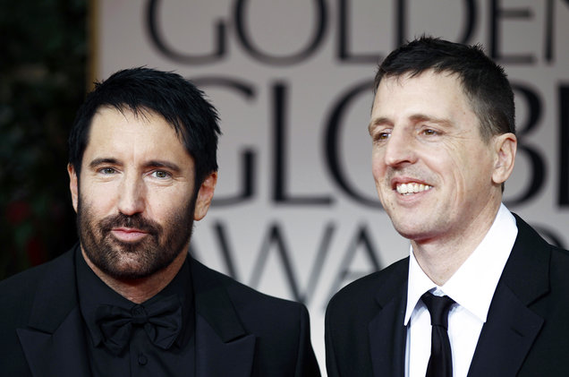 Trent Reznor and Atticus Ross arrive at the 69th Annual Golden Globe Awards on Jan. 15, 2012 in Los Angeles.