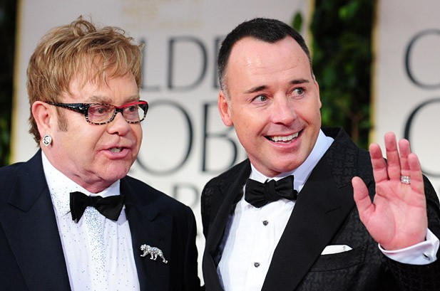 Elton John's Husband Rips Madonna; Stars Trade Barbs at Globes
